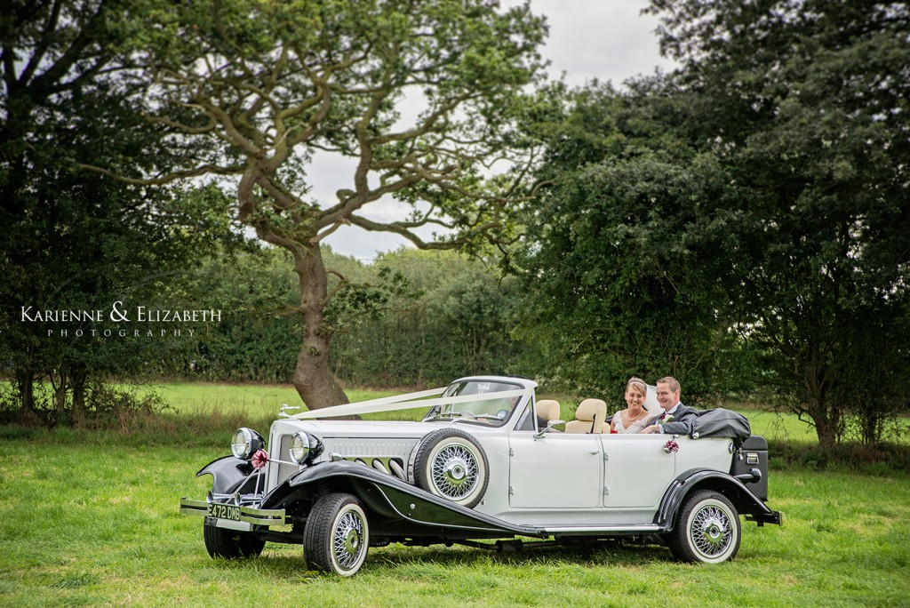 Happy Couple in the grounds of Sandon Hall, Staffordshire wedding